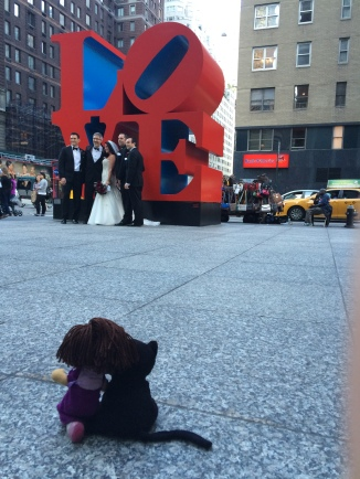 Black cat and Lil Girl in front of NYC LOVE sign
